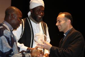 Imam Ashafa and Pastor James receive the 2009 Spiritual Solidarity Award from Father Daou (Photo:  Adyan)